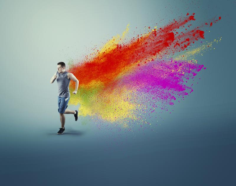 Sportman running running and a creative concept royalty free stock photo