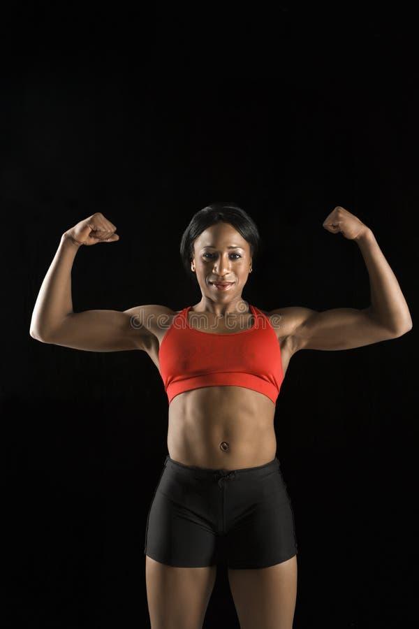 sportowiec w mięsień kobiety zdjęcia royalty free