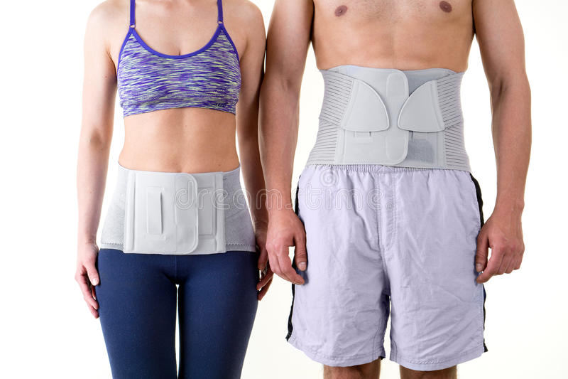 Sportowy mężczyzna i kobieta Jest ubranym Z powrotem poparcie brasy zdjęcia royalty free