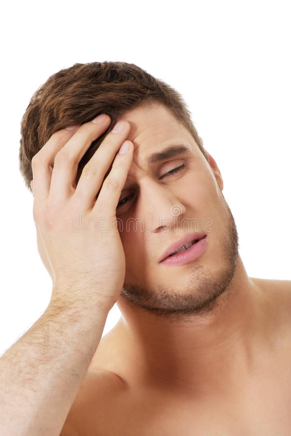 Sportowy mężczyzna uczucia ból w jego głowie obraz royalty free