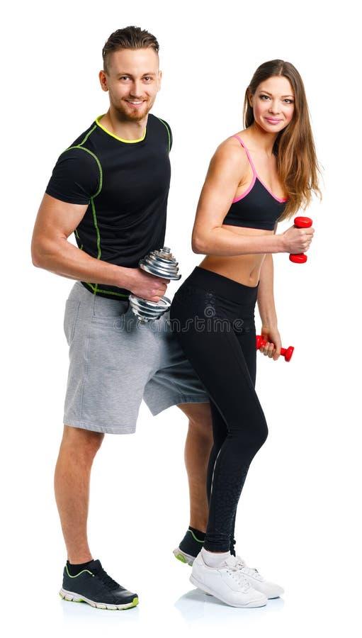 Sportpar - man och kvinna med hantlar på viten royaltyfria foton