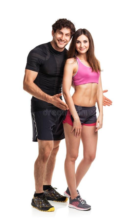 Sportpar - mannen och kvinnan efter kondition övar på viten arkivbild