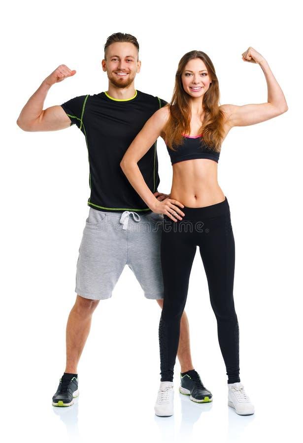 Sportpar - mannen och kvinnan efter kondition övar på viten royaltyfria foton
