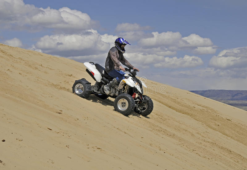 Sportquad downhill Sand mountain royalty free stock photography