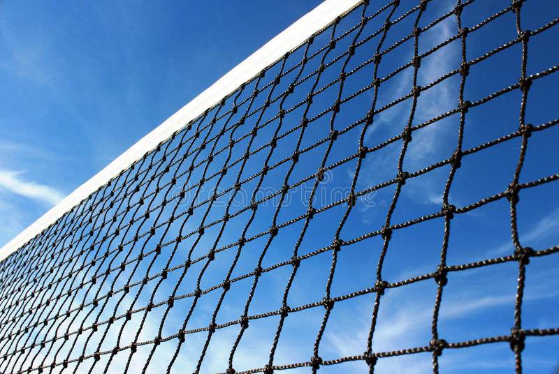 Sports. Abstract of a tennis net against a bright blue sky stock photos