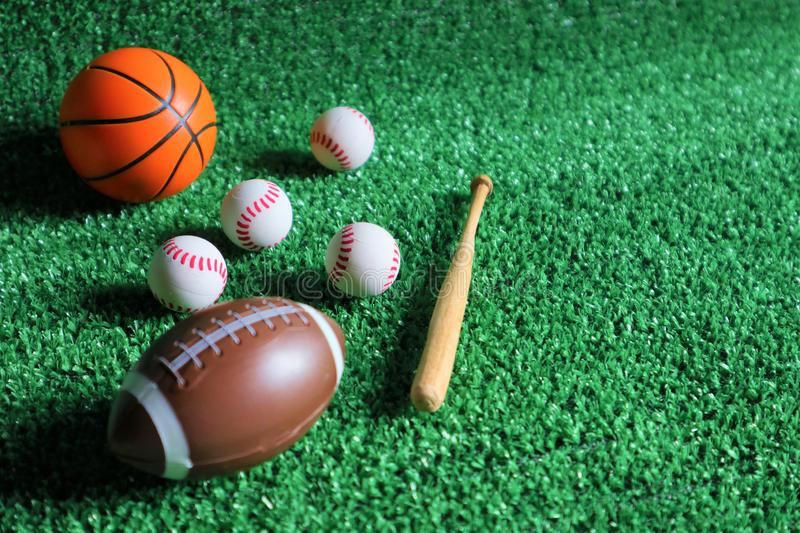 Sports accessories. sticks, balls on Green background royalty free stock image