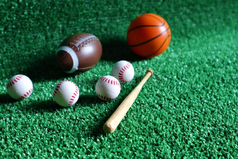 Sports accessories. sticks, balls on Green background stock photography