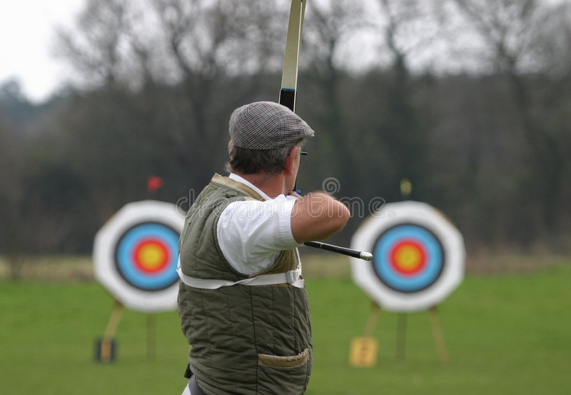 Sports Archer Aiming at Target stock photos