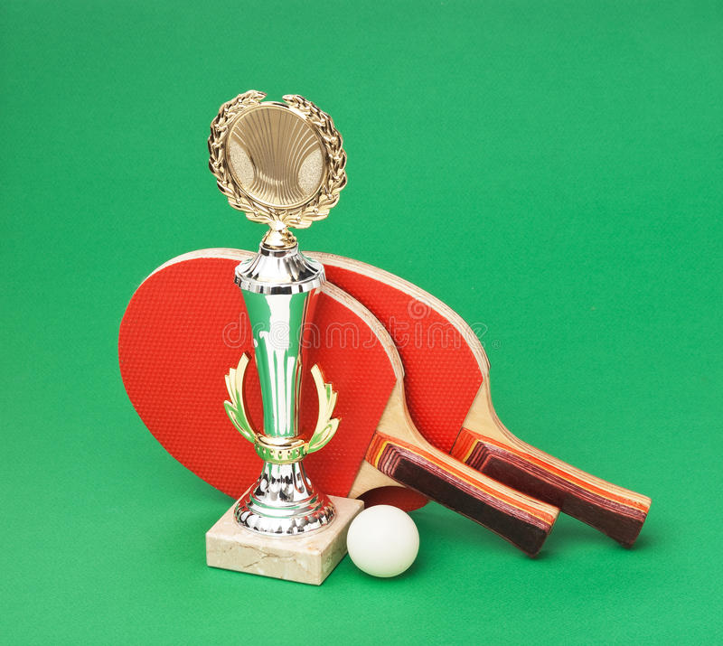 Sports Awards And  Tennis Racquets On  Green Table Royalty Free Stock Photography