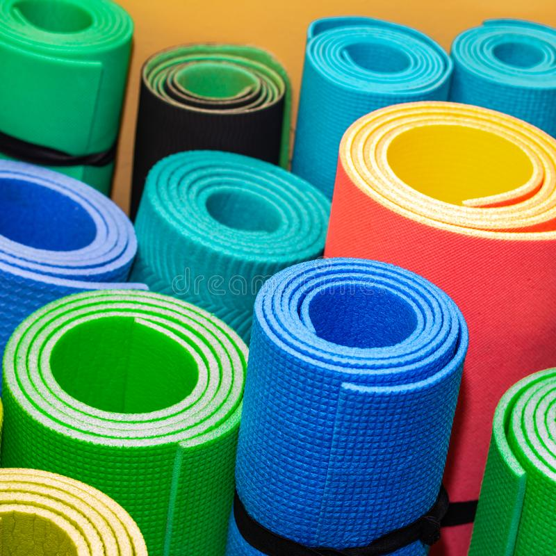 Sports background. Rolled the colored sports rugs.  royalty free stock image
