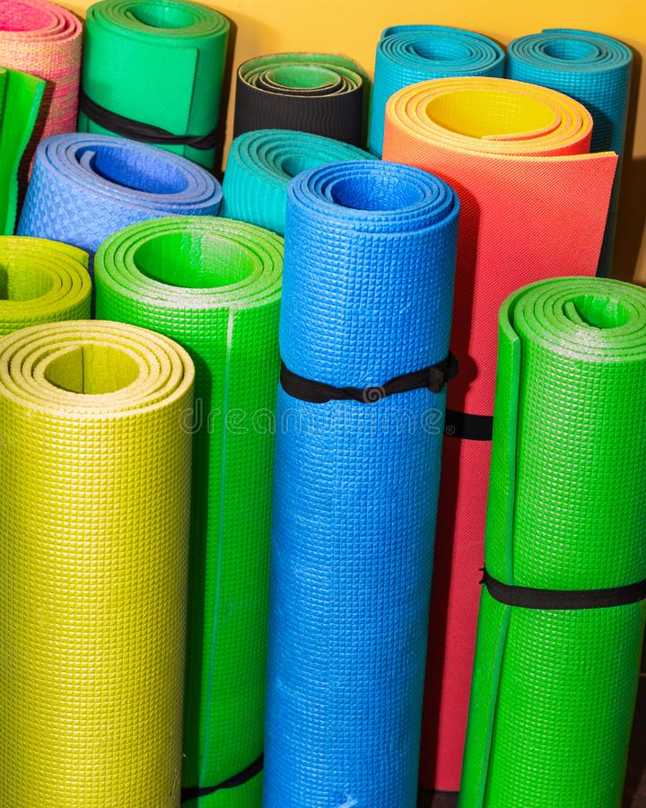 Sports background. Rolled the colored sports rugs.  stock image