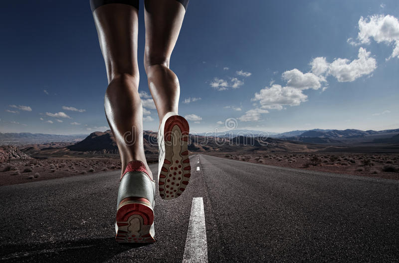 Sports background. Runner feet running on road closeup on shoe stock images