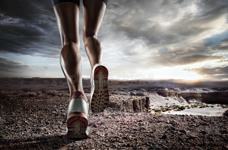 Sports background. Runner feet running on road closeup on shoe royalty free stock photography
