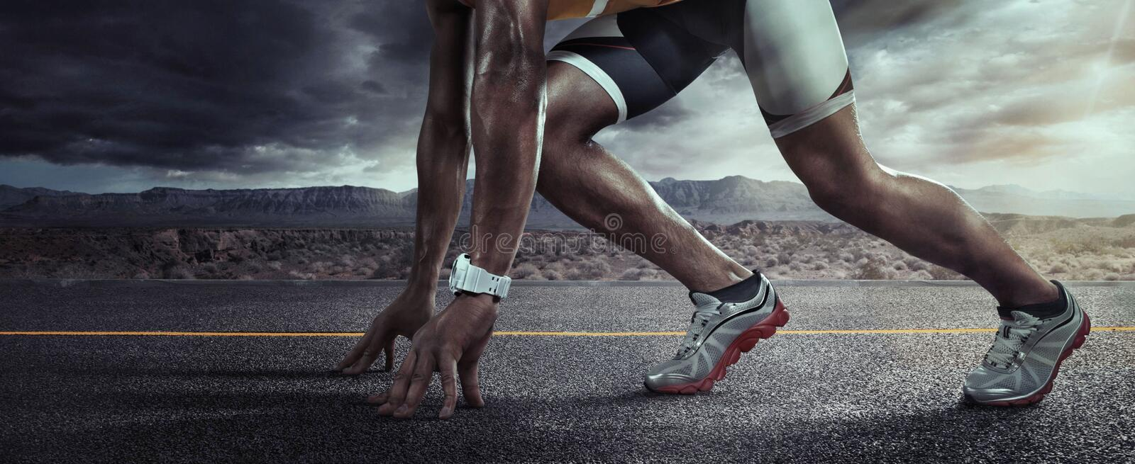 Sports background. Runner feet running on road closeup on shoe. Start line royalty free stock image