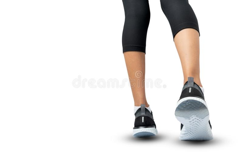 Sports background, Runner feet running on shoe isolated on white background, Sport woman running, Fitness and workout wellness. Concept stock image