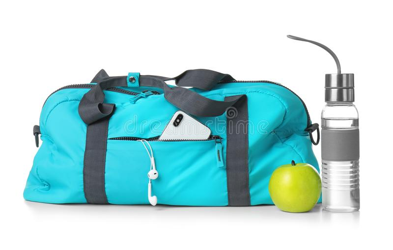 Sports bag and gym equipment on white background. Sports bag, apple and gym equipment on white background royalty free stock photo