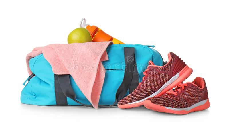Sports bag and gym equipment. On white background stock photos