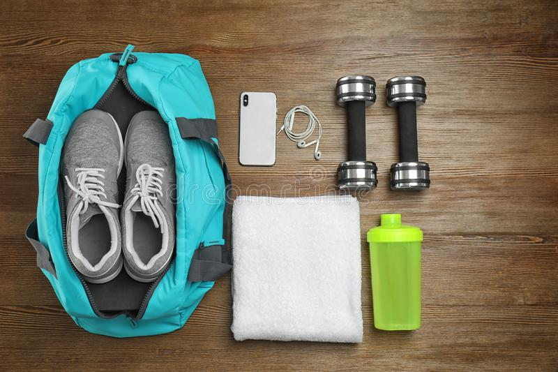 Sports bag and gym equipment royalty free stock photos