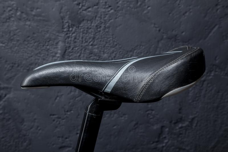 Sports bike seat. On a black background royalty free stock image