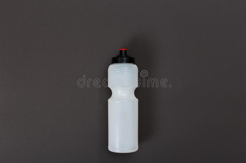 Sports bottle on dark background.Sport fashion, Sport accessories, Sport equipment. bottle with water. Sports bottle on dark background.Sport fashion, Sport royalty free stock photography