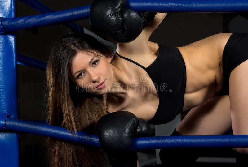 Sports Boxing Woman in black box gloves in fitness gym royalty free stock photo