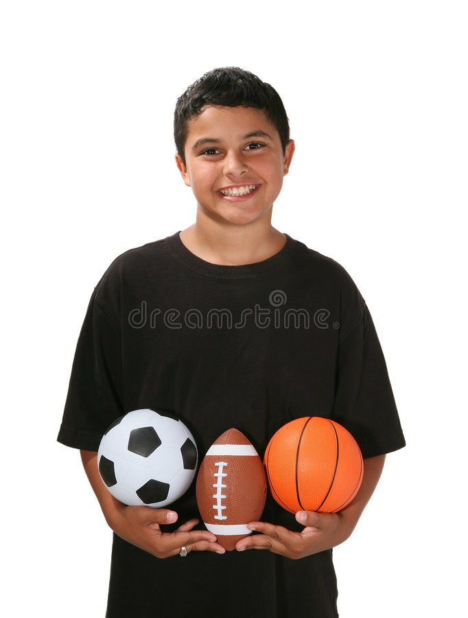 Sports Boy. Boy holding several sports balls royalty free stock photos