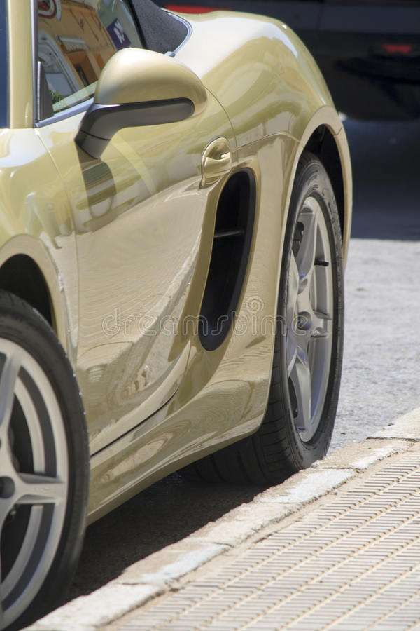 Sports Car. Detail of the bodywork of a sports car parked at the side of the road royalty free stock photography