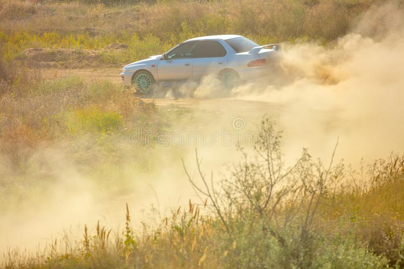 Sports Car on a Bend and a lot of Dust 01 royalty free stock photo