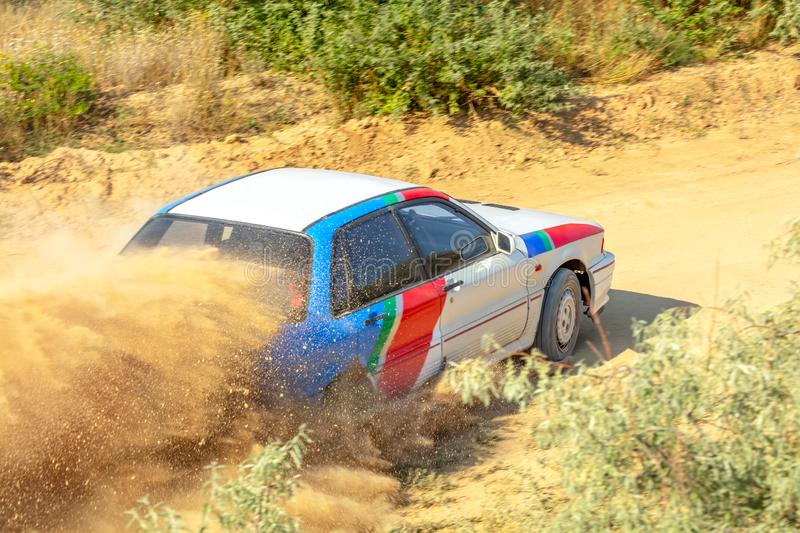 Sports Car on a Bend and a lot of Dust 04 stock image