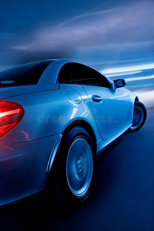 Sports Car Driving Fast. Sports Car In Motion Driving Fast, Speed Blur royalty free stock images