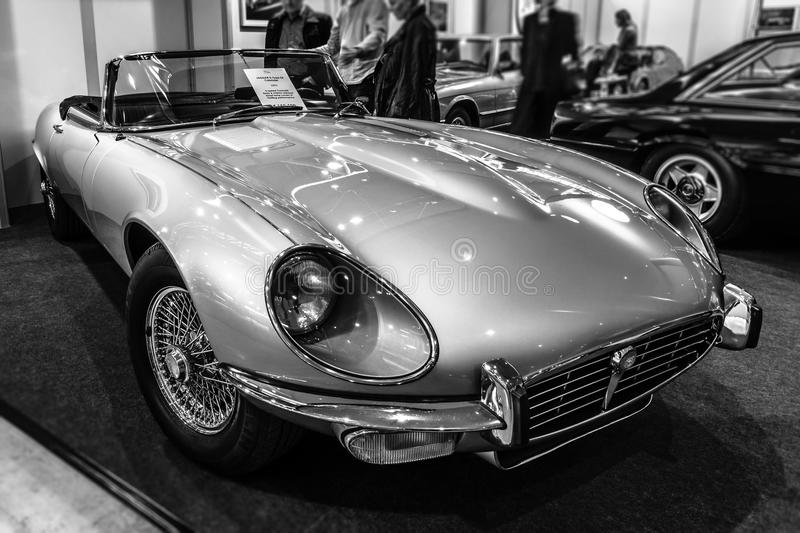 Sports car Jaguar E-Type Series 3 roadster, 1973. STUTTGART, GERMANY - MARCH 02, 2017: Sports car Jaguar E-Type Series 3 roadster, 1973. Black and white. Europe royalty free stock images