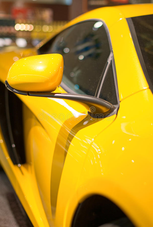 Sports car model. Part of yellow sports car model royalty free stock photography