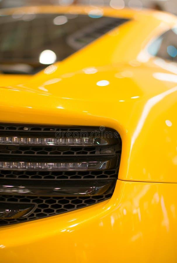 Sports car model. Part of yellow sports car model stock photo