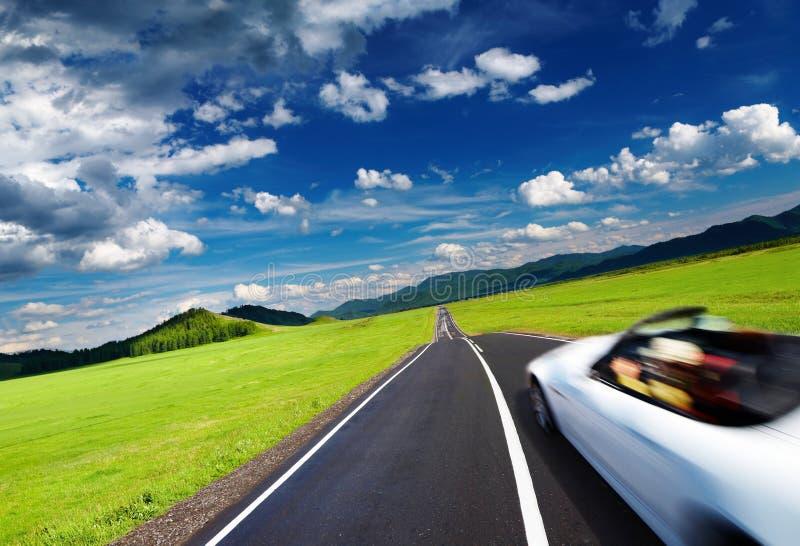 Sports car in motion blur. On empty road
