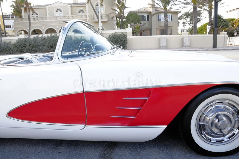 Sports car right fender. White and red sports car parked on the street in Fort Lauderdale beach, South Florida royalty free stock photography