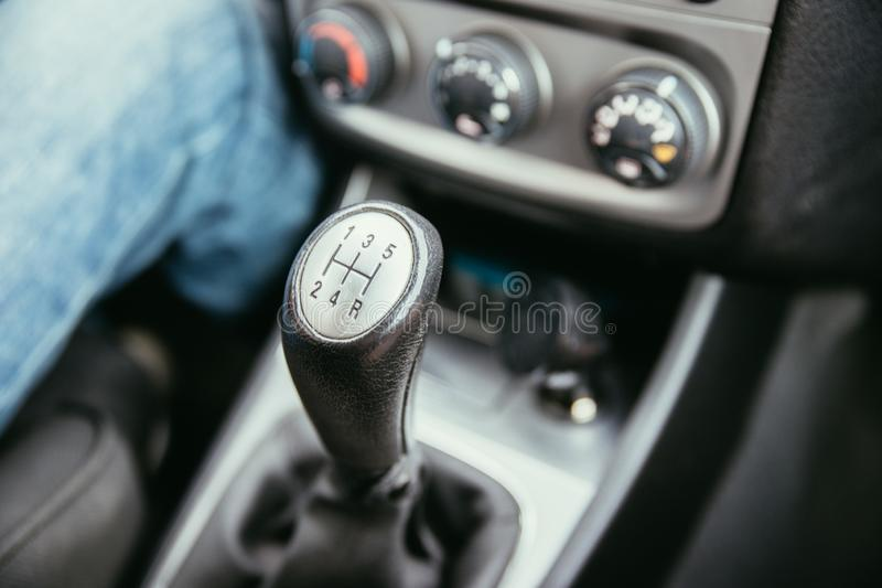 Sports car shift lever. Close up of a shift lever, sports car, gear, gearshift, control, driving, interior, sportscar, sporty, ride, autonomous, hybrid, drive royalty free stock photos