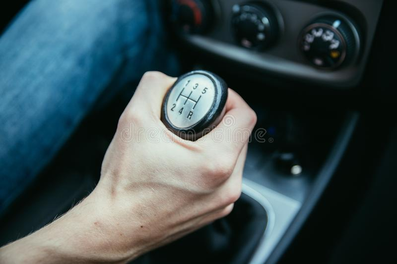 Sports car shift lever. Close up of a shift lever, sports car, gear, gearshift, control, driving, interior, sportscar, sporty, ride, autonomous, hybrid, drive stock image