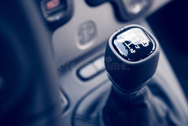 Sports car shift lever: Interior of a modern car. Close up of a shift lever, sports car, gear, gearshift, control, driving, interior, sportscar, sporty, ride stock photos
