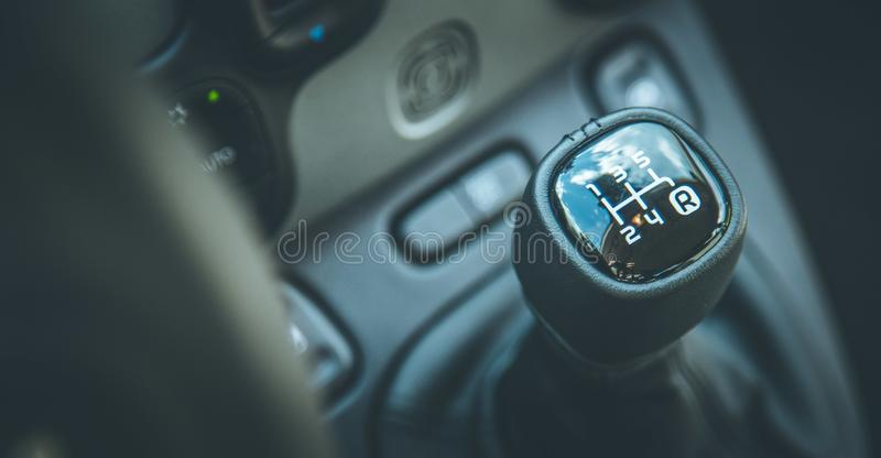 Sports car shift lever: Interior of a modern car. Close up of a shift lever, sports car, gear, gearshift, control, driving, interior, sportscar, sporty, ride royalty free stock photography