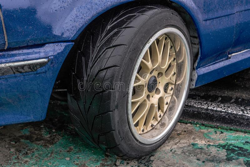 Sports car side view, alloy wheels royalty free stock images