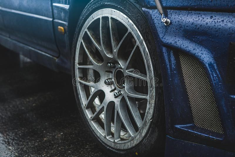 Sports car side view, alloy wheels royalty free stock photo