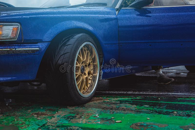 Sports car side view, alloy wheels stock images