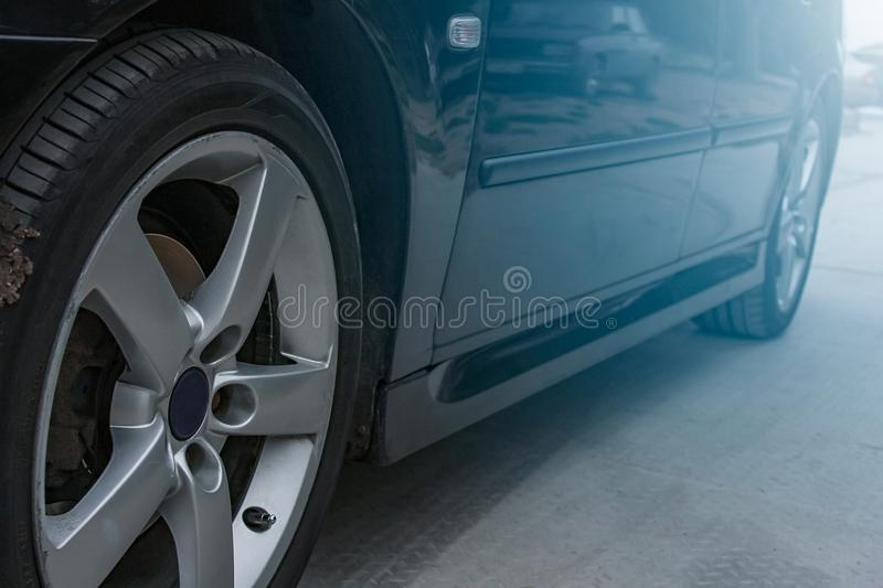 Sports car side view, alloy wheels stock photos