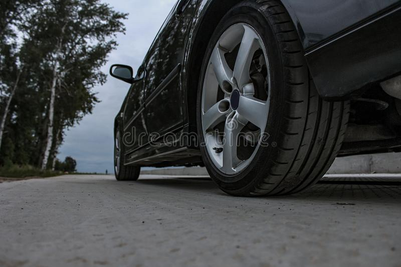 Sports car side view, alloy wheels stock image