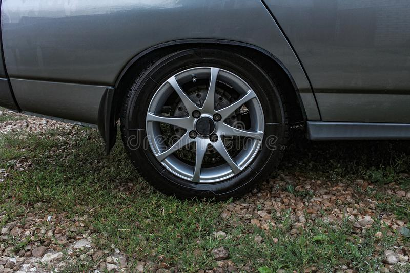 Sports car side view, alloy wheels royalty free stock photography