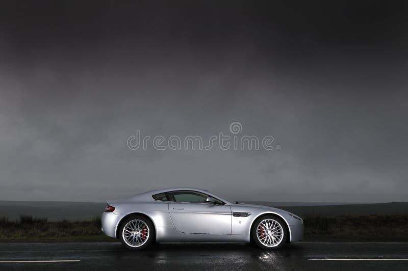 Sports car under stormy sky stock photography