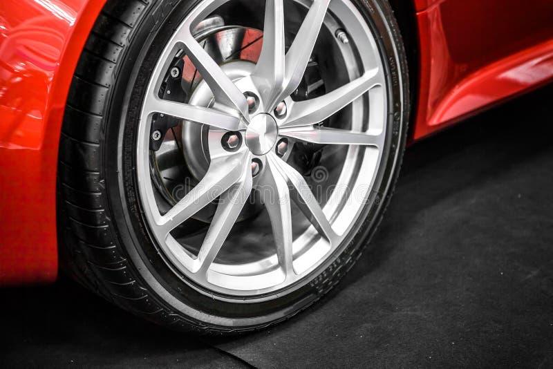 Sports car wheel. Close-up of sports car front wheel royalty free stock photos