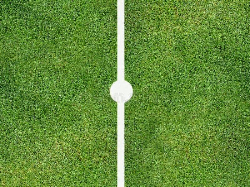 Sports centre spot. Sports pitch centre spot on grass stock illustration