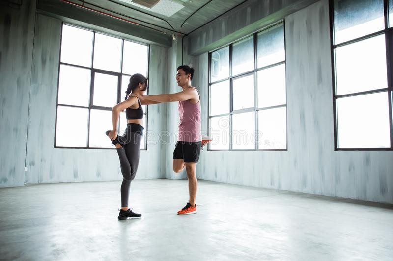 Sports couple warming up before to core exercise stock photos