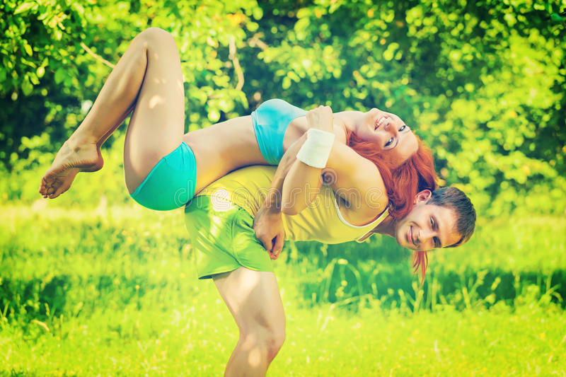 sports couple young man and girl playing in a park field instagram stile royalty free stock image